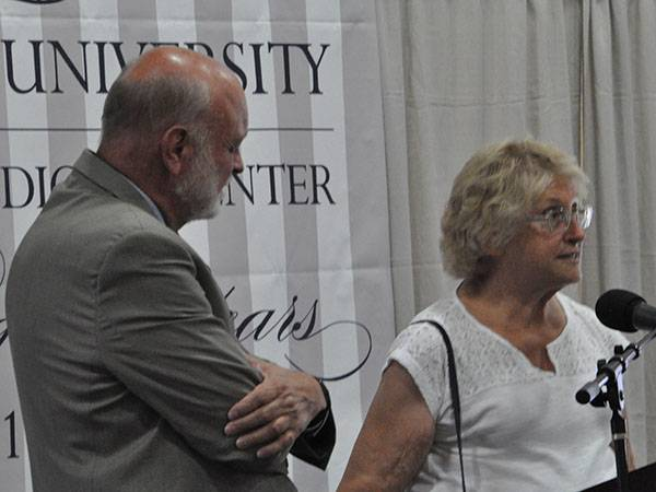 Dr. Hart invites Lyn Behrens up to the stage