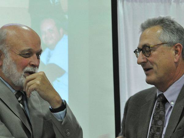 Dr. Richard Hart and Kerry Heinrich, JD share a moment