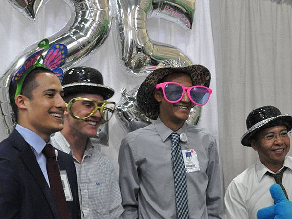 Many took advantage of the photo booth that was available, commemorating the 25th Anniversary