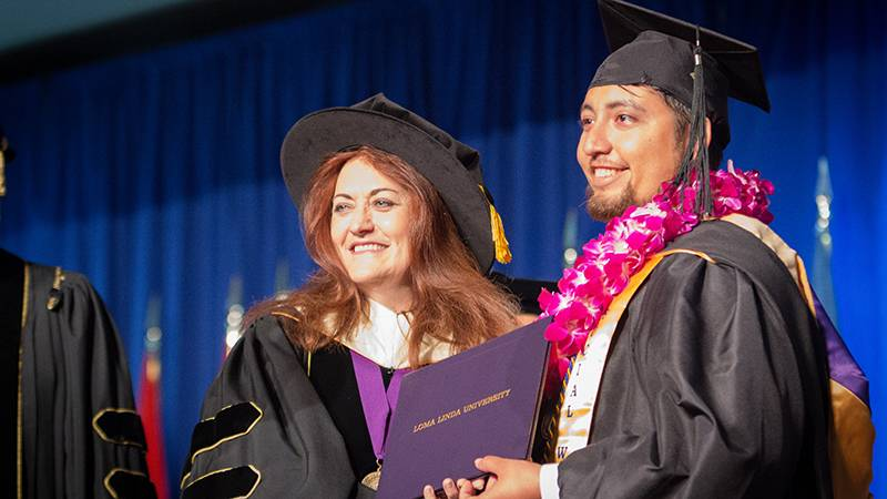 Dean Beverly Buckles, DSW, and one of her graduates of the School of Behavioral Health share matching grins.