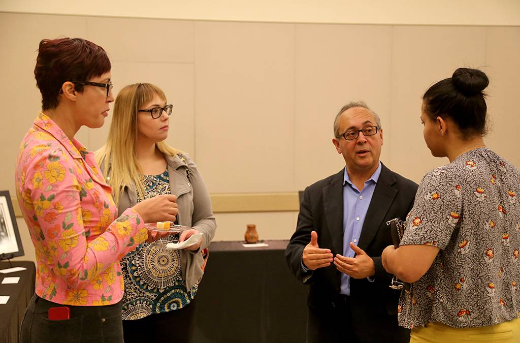 Carlos Casiano, PhD, with Leanne Burnham (left), Christina Du Ross (center), and Alfida Fernandez.