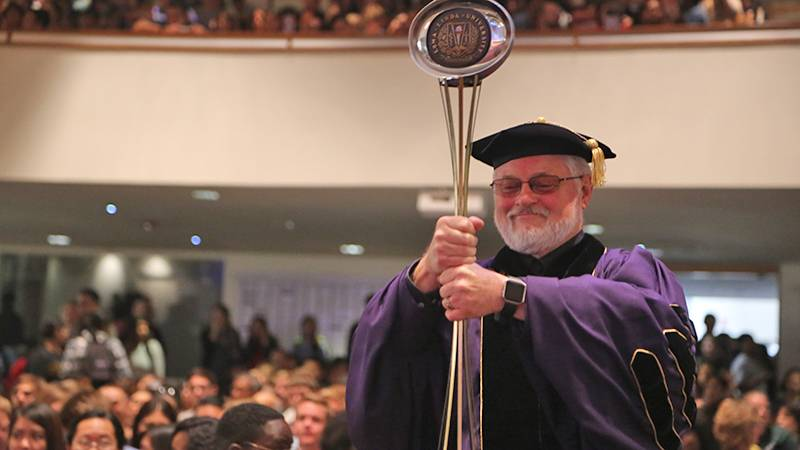 Provost Ron Carter, PhD, carries in the ceremonial mace.