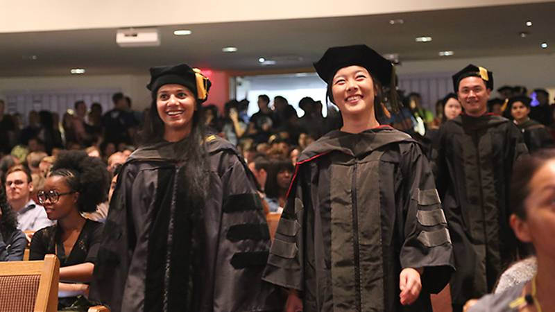 Faculty members in full regalia march in the opening processional.