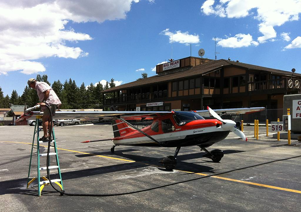 Despite losing his tongue and larynx to cancer, Dave Ammenti enjoys an active, fulfilling life. Here he refuels at Big Bear Airport.