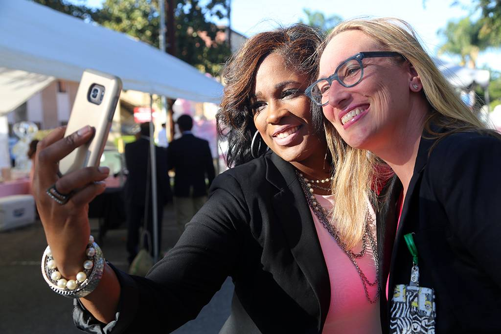 Shay Manns (L) and Andrea Ray, MD, celebrate Breast Cancer Awareness Day with a double selfie.