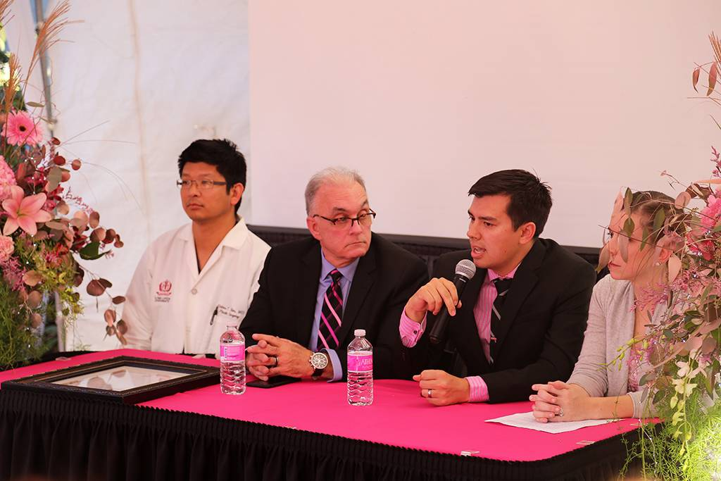 Jerry Chidester, MD, answers a question as Hahns Kim, MD, Michael Hill, MD, and Rachel Ford, MD, look on.