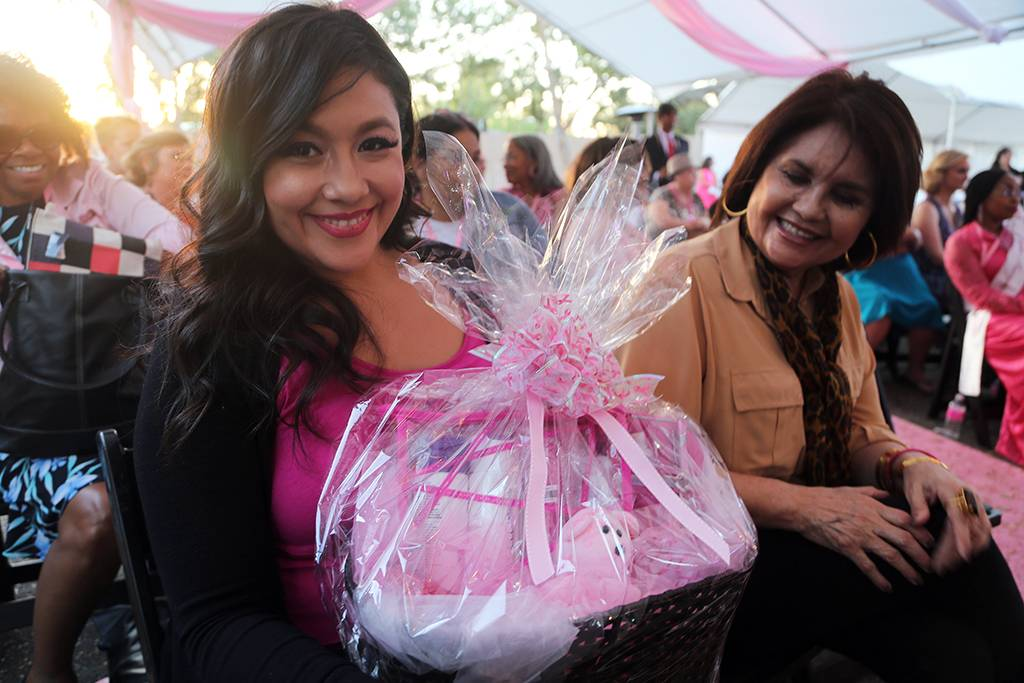 Nelly Fuentes smiles after winning a gift basket.