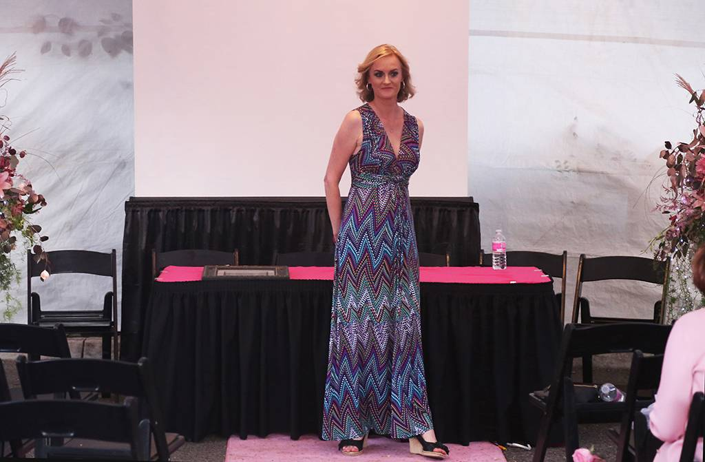 Ann Leverton takes a walk on the Pink Runway to celebrate her life after breast cancer.