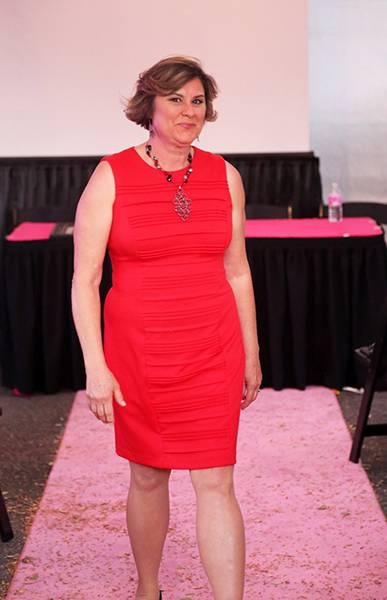 Pam Null's smile and bright red dress reflect her upbeat attitude on life without cancer.