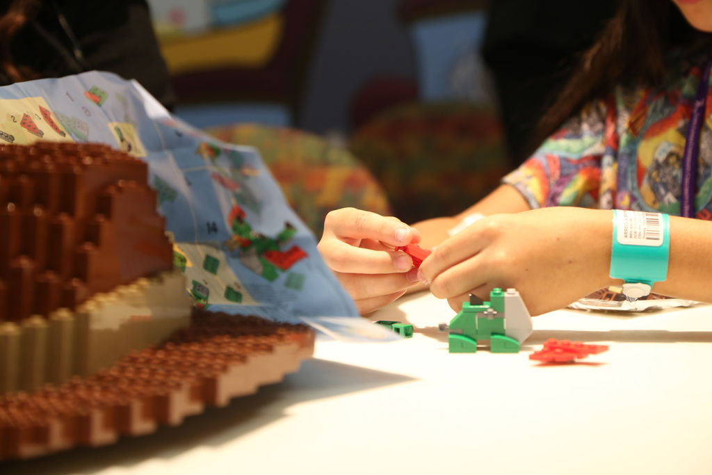 A patient from the LLU Children's Hospital plays with legos