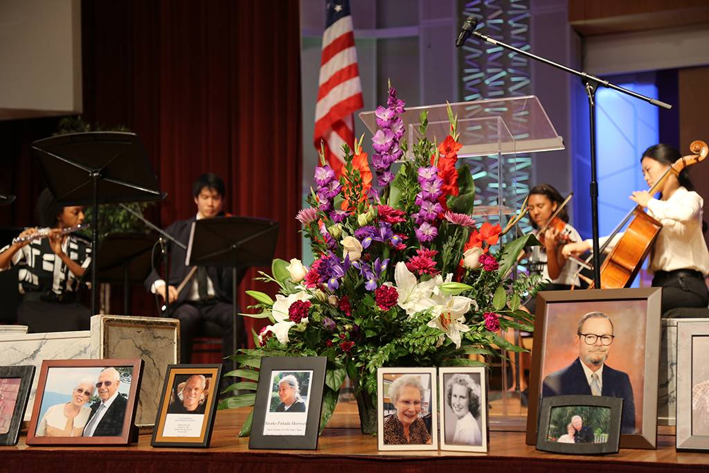 Pictures of the deceased graced the front of the sanctuary at the service.