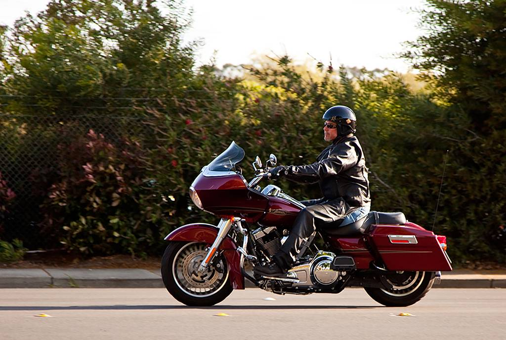 John Ready rides off on his 2009 Harley-Davidson Road Glide to encourage and support a laryngectomy patient. He makes up to 200 site visits per year.