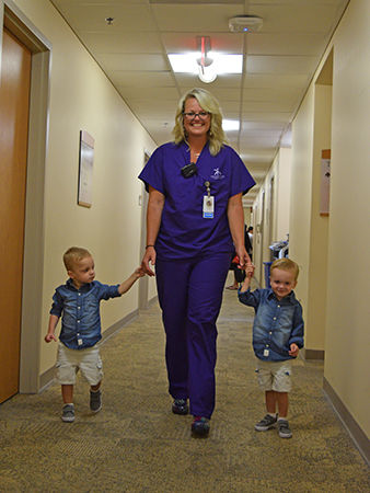 Courtney Martin takes a stroll with the boys—Lucas (left) and Jacob (right).