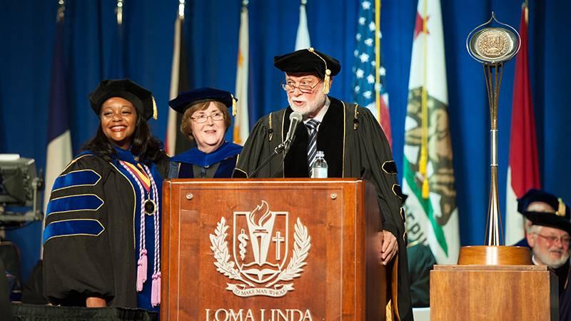 Shaunna Siler (left) received the School of Nursing Dean's Award for PhD graduates from Dean Elizabeth Bossert, PhD, and Richard Hart, MD, DrPH, president of Loma Linda University Health.