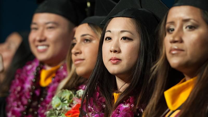 Nursing graduates take in the ceremony.