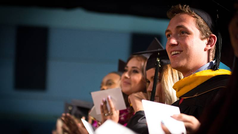 A graduate enjoys a moment during the ceremony for the Schools of Religion and Behavioral Health.