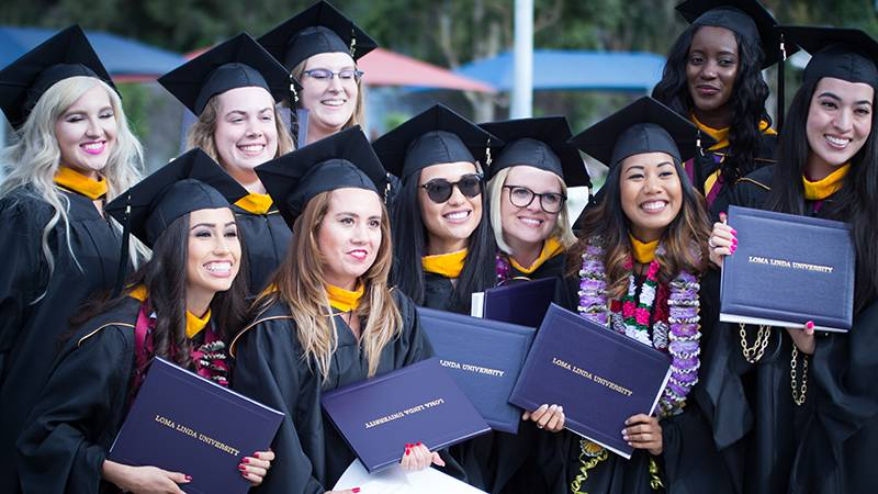 After the religion and behavioral health commencement, these women gather for a group photo.