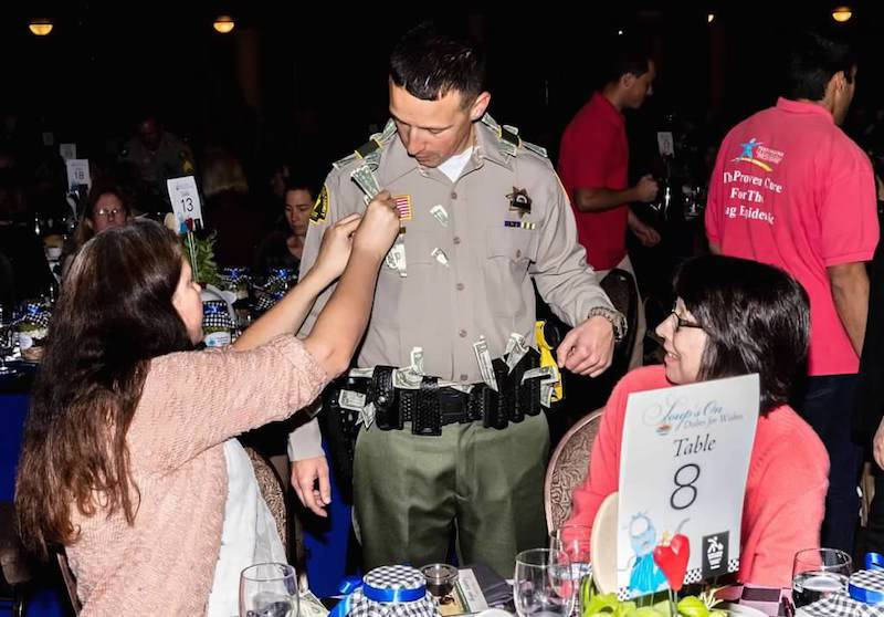 Men and women in uniform earned tips serving guests during Dishes for Wishes. All tips were donated to LLUCH.
