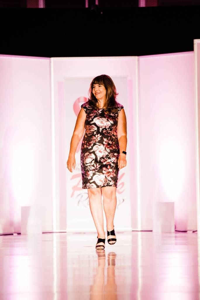 Maria Knapp begins her walk down the runway. Photographed by Jennifer Costa Photography