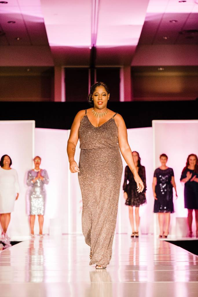 Shay Manns stands tall as she walks for the last time on the runway. Photographed by Jennifer Costa Photography