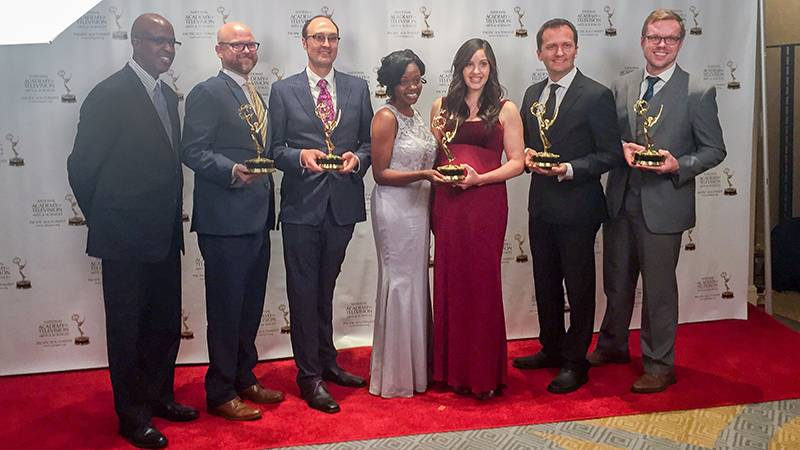 On the red carpet with their Emmy Awards, from left: Garrett Caldwell, Michael Wolcott, James Pendorf, Keturah Reed, Patricia Kelikani, Cosmin Cosma and Erik Edstrom.
