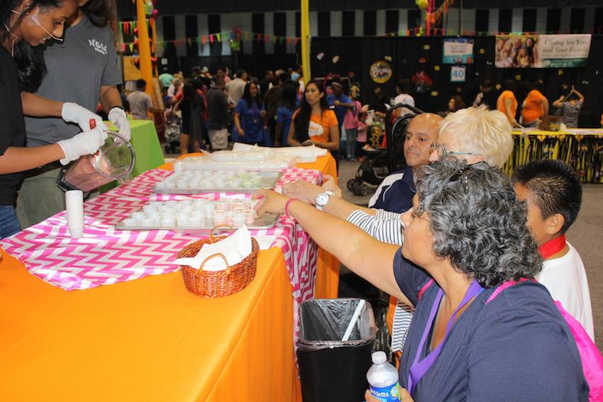 Health Fair guests were eager to try the smootie samples.