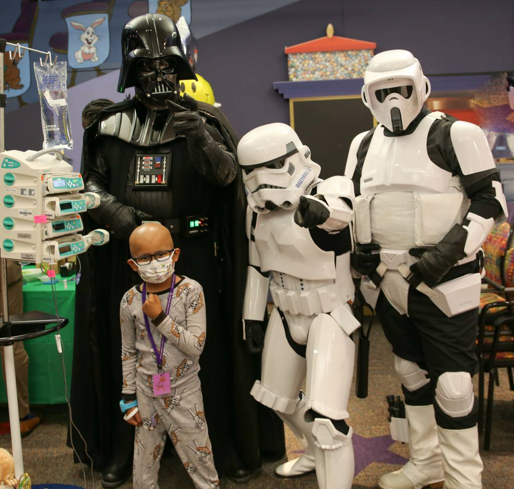 LLUCH patient, Edgar Rodriguez, 6, from San Jacinto, with Star Wars characters. Booths were put on by the community for Luke's Pride Spring Community Day, Thursday, May 17.