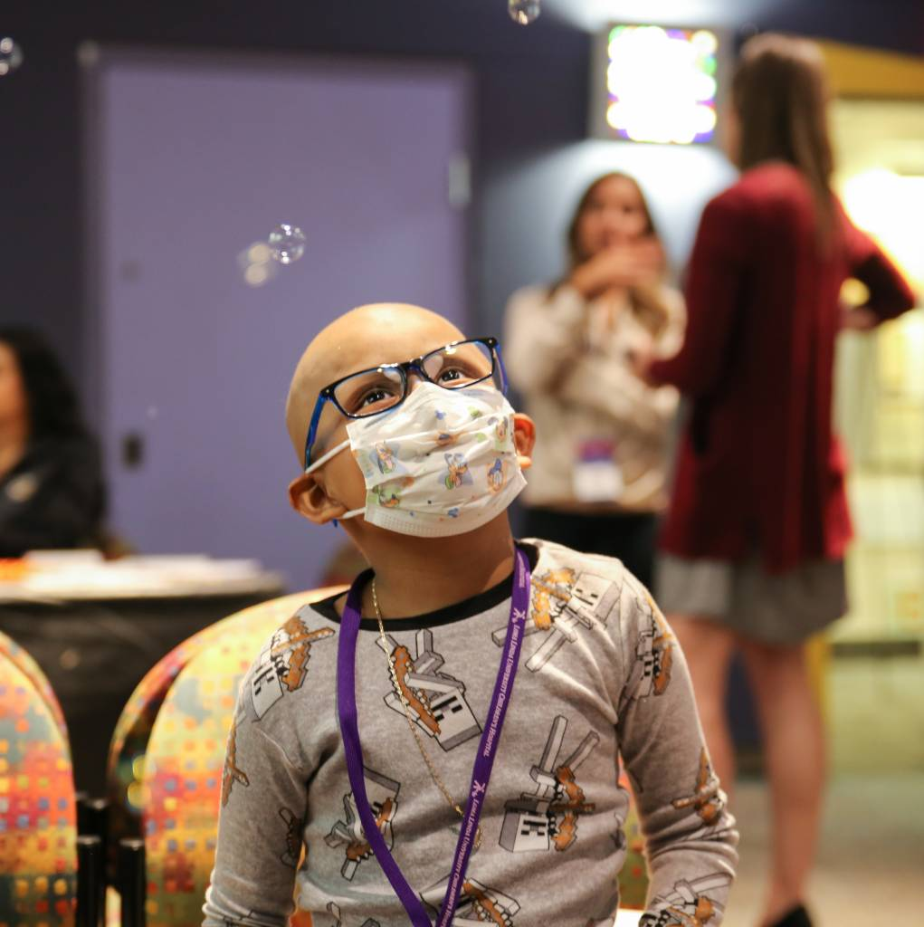 LLUCH patient, Edgar Rodriguez, 6, from San Jacinto, watching and popping bubbles. Booths were put on by the community for Luke's Pride Spring Community Day, Thursday, May 17.