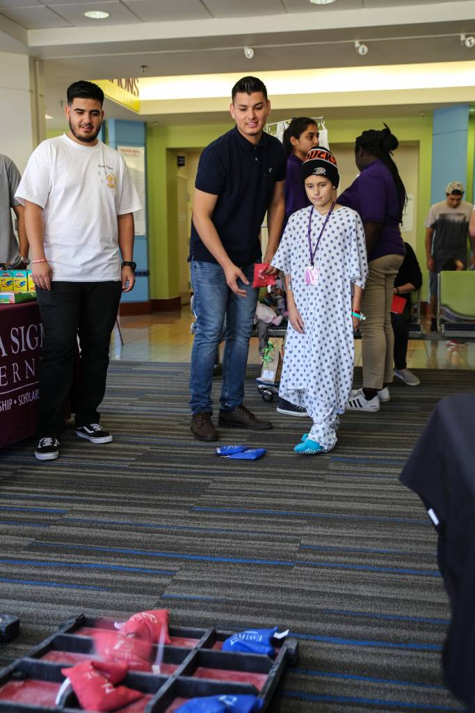 Kappa Sigma Fraternity at CSUSB playing games with patients. Booths were put on by the community for Luke's Pride Spring Community Day, Thursday, May 17.