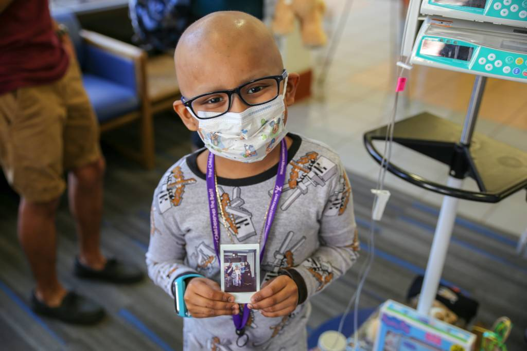 LLUCH patient, Edgar Rodriguez, 6, from San Jacinto, showing a photo of him and the Princess Spirit team. Booths were put on by the community for Luke's Pride Spring Community Day, Thursday, May 17.
