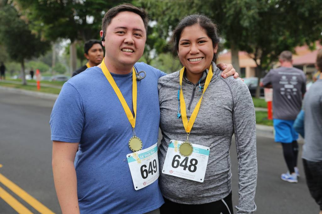 Husband Andrew and expecting wife Melody Ezpeleta, both students at the School of Behavioral Health, ran with their dog. The Stand up to Stigma 5K raised both funds for a new playground and awareness for mental health issues.