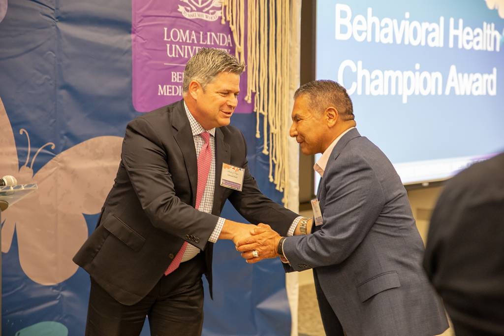 Edward Field, MBA, vice president for the Behavioral Medicine Center shakes hands with San Manuel Tribal Secretary Ken Ramirez.