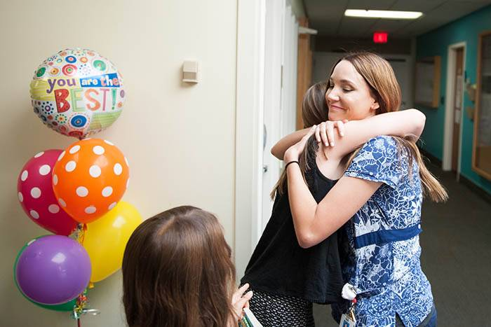 Tramel gave Janelle Cicero, RN a warm hug as she arrived at the Children's Hospital.