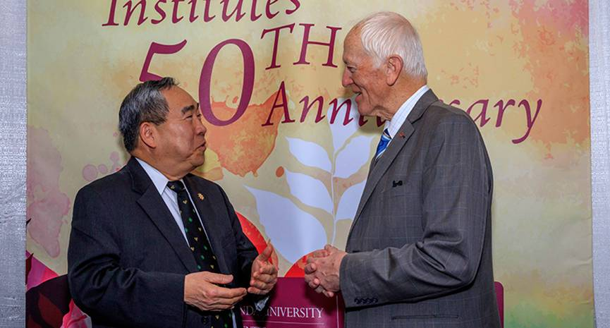 Infant heart transplant pioneer Leonard Bailey, MD, speaks with former acting Surgeon General Kenneth Moritsugu, MD, MPH, at the 50th anniversary celebration of organ transplantation at Loma Linda University Health. Moritsugu advocates for organ donation as both a public health issue and a personal mission. In separate vehicular accidents in the 1990s, both his wife and one of his daughters died. Knowing their donated organs helped others live brought solace to Moritsugu.