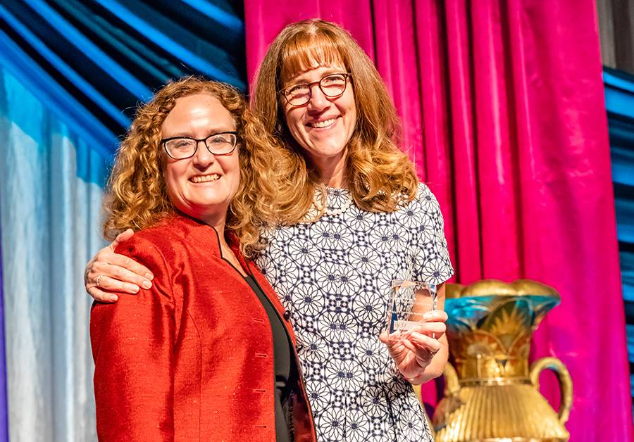 Penny Duerksen-Hughes, PhD., (left) received the Community Health Benefit award for her work to fight Human Papilloma Virus. Judy Chatigny, executive director of the Loma Linda University Cancer Center, made the presentation.