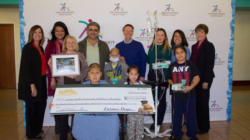 LLUCH Patients and staff were all smiles as they accepted a check from Farmer Boys Wednesday, Feb. 8 in the hospital lobby.