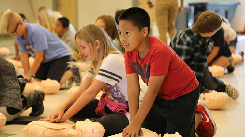 Students at Chapman Heights Elementary participate in CPR training.