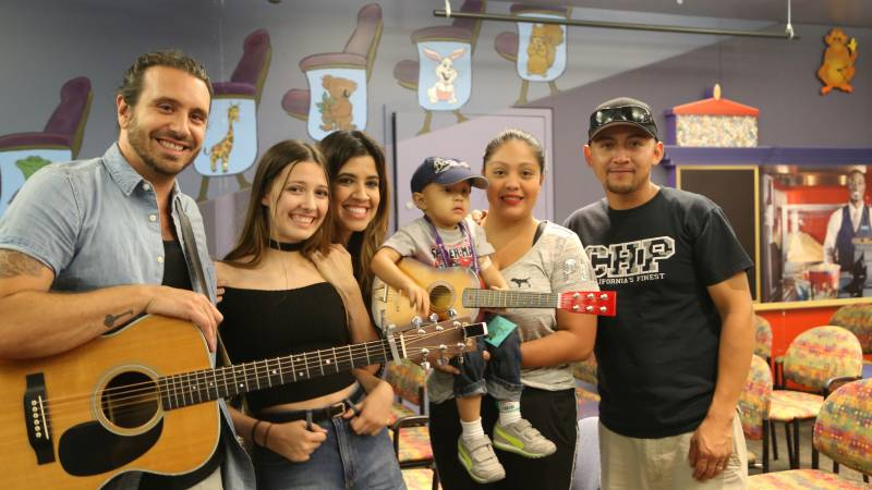 Members of the family band Edgar were all smiles as they greeted patients prior to their performance at LLUCH Tuesday, July 26. From left, Ryan Edgar, Jaslyn Edgar, Nikki Leonti-Edgar, LLUCH patient Franco Gonzalez Bucio, 2, along with mom and dad Maria and Rafael Gonzalez Bucio.