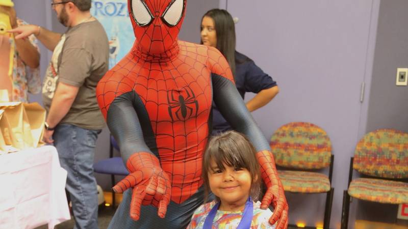 LLUCH patient Ximena Sanchez, 5, from Lancaster, was all smiles as she made the acquaintance of Spiderman at the annual Fall Community Day at Loma Linda University Children's Hospital Tuesday, Aug. 16.