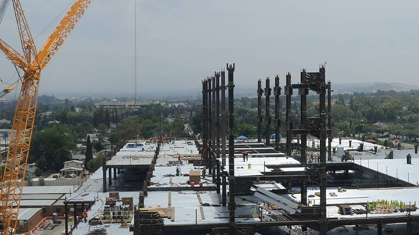 The first steel beams of the new Adult Hospital tower stand in place.
