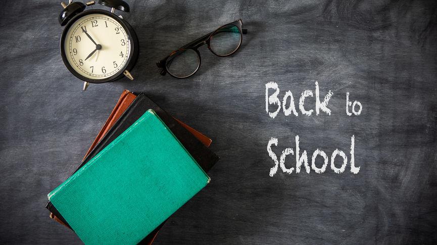 Desk Of Student, Alarm Clock, Books and Pencils