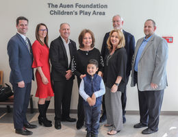 hospital administrators, city representatives, a the auen foundation cut ribbon
