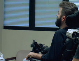 """Jeffrey Rosenfeld, MD, PhD, (left) consults with ALS patient Anthony Carbajal during a routine visit that was filmed for an episode of """"My Last Days,"""" scheduled to air on the CW this spring. (Photo courtesy of Wayfarer Entertainment)."""