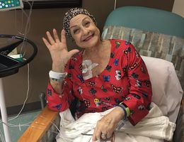 Michelle Arrigo smiles big as she holds up five fingers to signal her fifth of twelve rounds of infusion therapy at Loma Linda University Health – Beaumont – Banning in early 2020. Comprised of various therapies and a 14.5 hour surgery, Arrigo's arduous battle against pancreatic cancer ended in triumph when doctors declared she had No Evidence of Disease (NED).