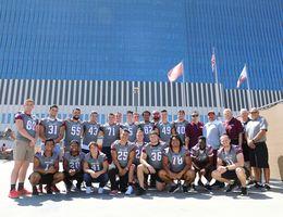 University of Redlands football team visits pediatric patients