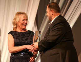 Helen Staples-Evans, DNP, MS, RN, accepts the award for Outstanding Clinician from Scott Perryman at the 25th Anniversary Reflection Foundation Gala