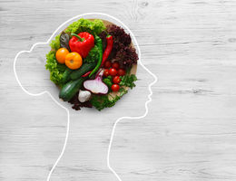 girl outline with healthy food creating her brain