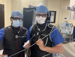 From left, cardiologists Harit Desai, MD, and Niraj Parekh, MD, hold surgical equipment used to repair patients' heart valves during TMVr — a procedure that saved Elenita Tan's life in December 2020.