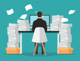 Graphic of man at desk overworking