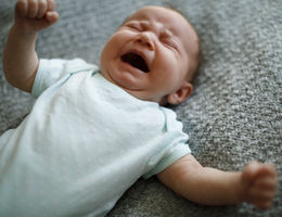 Little baby boy crying with opened mouth